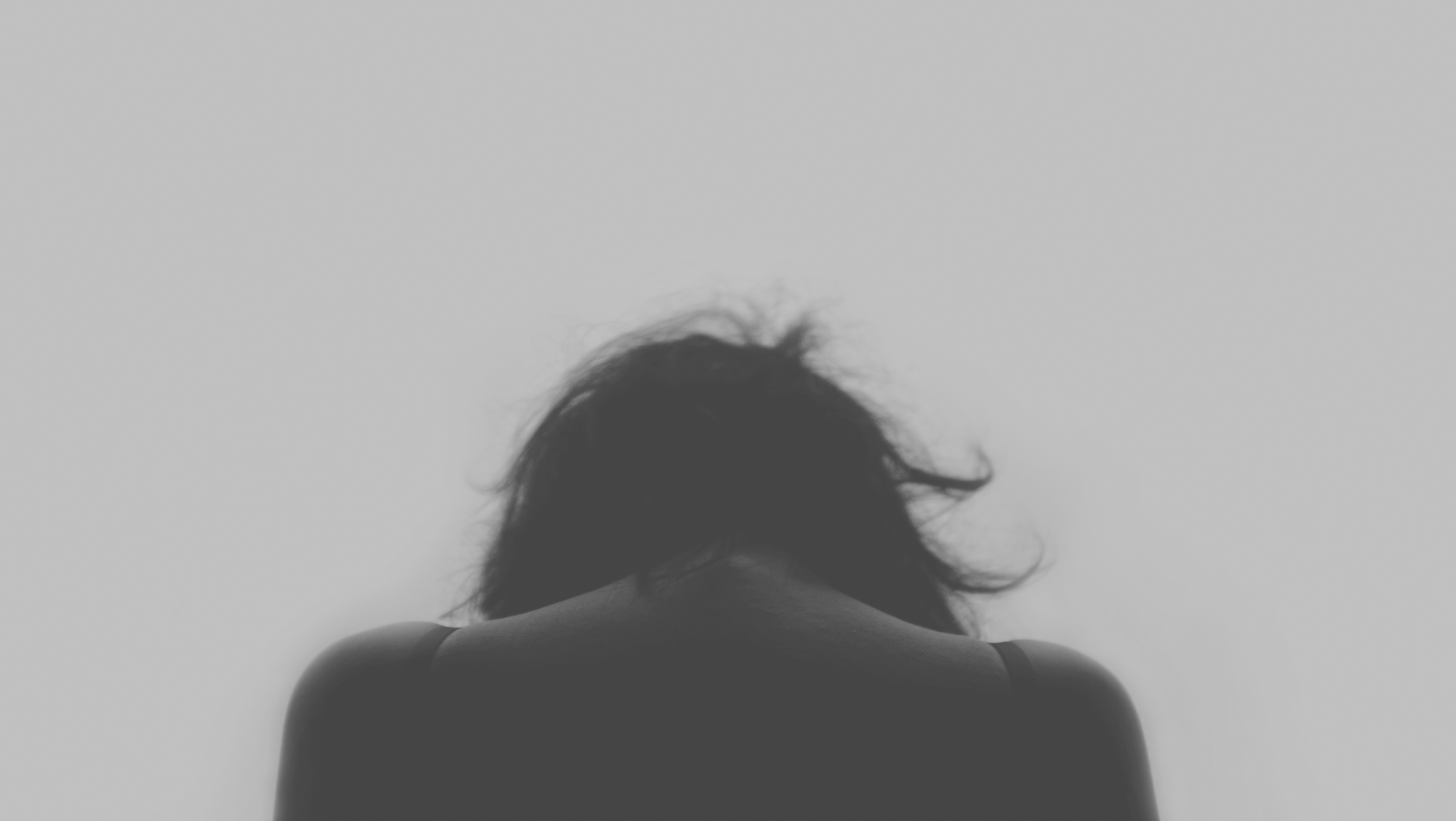 Fears | a black and white photo of a woman, head bowed